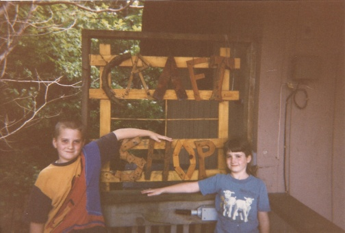My younger brother and sister outside the camp's crafting area
