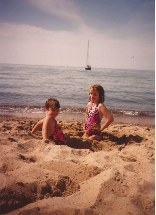 Me and my older sister, in a hole at Lake Michigan
